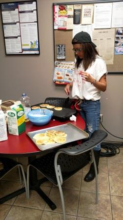 Lisa Milom Making Corn Cakes